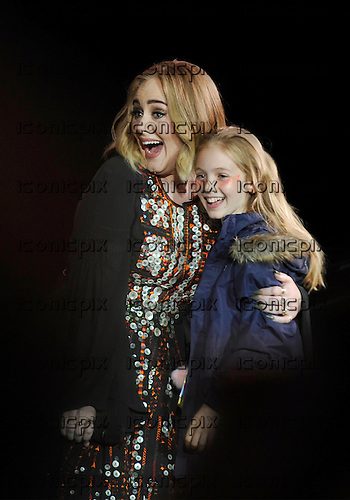 ADELE - with 10 year old fan Lyla - performing live on the Pyramid Stage on Day Two at the 2016 Glastonbury Festival at Worthy Farm Pilton Somerset UK - 25 Jun 2016.  Photo credit: Zaine Lewis/IconicPix