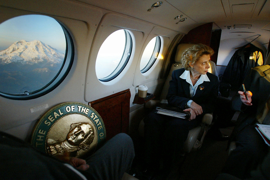 Even with Mt. Rainier glowing in the window, Governor Gregoire keeps working on the return flight from Yakima on March 10, 2005. She took a few brief moments to enjoy the view of the mountain, but went back to work with environmental policy advisor Keith Phillips.