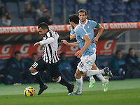 Carlos Tevez   in action during the Italian Serie A soccer match between   SS Lazio and FC Juventus   at Olimpico  stadium in Rome , November 22, 2014