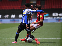 28th June 2020; Ashton Gate Stadium, Bristol, England; English Football League Championship Football, Bristol City versus Sheffield Wednesday; Moses Odubajo of Sheffield Wednesday tackles Jamie Paterson of Bristol City in the penalty area