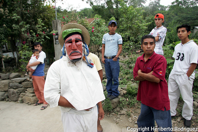Native people stand next each other as they attend the Xantolo Days (Day of the Deads) in their village of Jaltocan, in northern state of Hidalgo. Photo by Heriberto Rodriguez