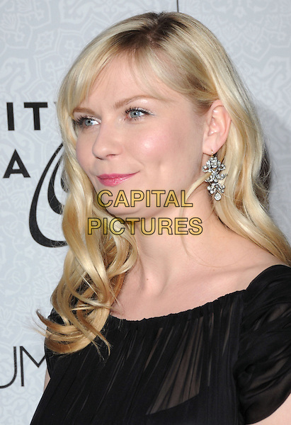 "KIRSTEN DUNST.Art of Elysium 3rd Annual Black Tie charity gala '""Heaven"" held at 990 Wilshire Blvd in Beverly Hills, California, USA, .January 16th 2010 .headshot portrait black wavy hair fringe lipstick make-up earrings silver sheer silk chiffon see thru through double chin.CAP/RKE/DVS .©DVS/RockinExposures/Capital Pictures"
