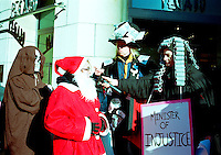 Dec 15,  2001, Montreal, Quebec, Canada<br /> <br /> A group of peaceful demonstrator, do a mock trial of Santa Claus by the Minister of Justice diring a  march on Ste-catherine Street in downtown Montreal, CANADA, December 15, 2001, to protest against the anti-terrorism law C-36 and the C_35 and C-42 proposed laws.<br /> <br /> They are afraid that the C-36 law will be used to target anti-globalization, ecology,native indians groups and  unions.<br />  <br /> Mandatory Credit: Photo by Pierre Roussel- Images Distribution. (©) Copyright 2001 by Pierre Roussel <br /> ON SPEC<br /> NOTE : scan from 35mm neg,  saved in Adobe 1998 RGB.