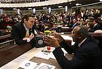Nevada Attorney General Adam Laxalt, left, talks with Assemblyman Harvey Munford, D-Las Vegas, before opening day ceremonies at the Legislative Building in Carson City, Nev., on Monday, Feb. 2, 2015. (Cathleen Allison/Las Vegas Review-Journal)