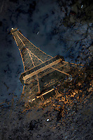 Eiffel Tower, March 31, 1889 (Universal Exhibition in celebration of the French Revolution), Alexandre Gustave Eiffel (1832-1923), 324 meters high, 10,100 tons, 18,038 pieces, 2,500,000 rivets, 1665 steps, seen on January 16, 2011 reflected in a pond, Paris, France. Picture by Manuel Cohen