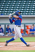 AZL Rangers left fielder Marcus Mack (2) follows through on his swing against the AZL Cubs on July 24, 2017 at Sloan Park in Mesa, Arizona. AZL Cubs defeated the AZL Rangers 2-1. (Zachary Lucy/Four Seam Images)
