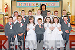 Pupils of Dromclough NS who received their First Holy Communion at Our Lady of Fatima and St Senan's Church, Irremore on Saturday front l-r: Lorcan Leahy, Liam Roos, Emma Faley, Michael Hennessy, Kalin Faley. Orla Dillon and Se?amus Stack. Back l-r: Clodagh Murphy, Michael Kelliher, Mark Moore, Aisling Kelly, Marion Foran (teacher), Ruth Moore, Liam Quilter and Ronnie Downey.