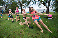 NWA Democrat-Gazette/BEN GOFF @NWABENGOFF<br /> Campers and counselors compete in tug of war Tuesday, Aug. 6, 2019, during the Summer Day Camp at the Rogers Activity Center. This week's camp is the center's final session of the summer season.