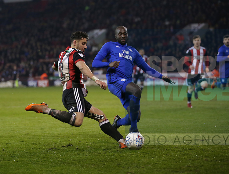 George Baldock of Sheffield Utd attempts to cross past Sol Bamba of Cardiff City during the Championship match at Bramall Lane Stadium, Sheffield. Picture date 02nd April, 2018. Picture credit should read: Simon Bellis/Sportimage