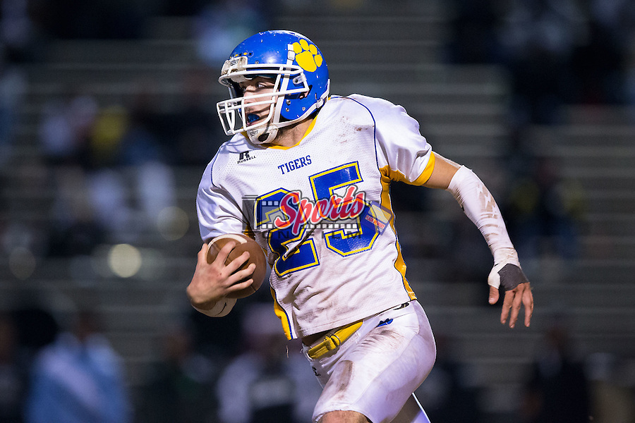 Justice Isenhour (25) of the Mount Pleasant Tigers returns a kick during second half action against the Shelby Golden Lions at George Blanton Memorial Stadium November 27, 2015, in Shelby, North Carolina.  The Golden Lions defeated the Tigers 38-27.  (Brian Westerholt/Sports On Film)