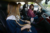 Tuesday, May 19, 2020, during a drive-in senior awards ceremony at the school in Springdale. Graduates and their families watched a video on a screen like a drive-in movie with the audio playing over their car radios. The school plans a graduation ceremony for July 7. Visit nwaonline.com/200520Daily/ for today's photo gallery.<br /> (NWA Democrat-Gazette/Andy Shupe)