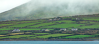 County Kerry, Ireland:<br /> Morning fog blankets pastures and farms of Portmagee, on the tip of the Iveragh peninsula