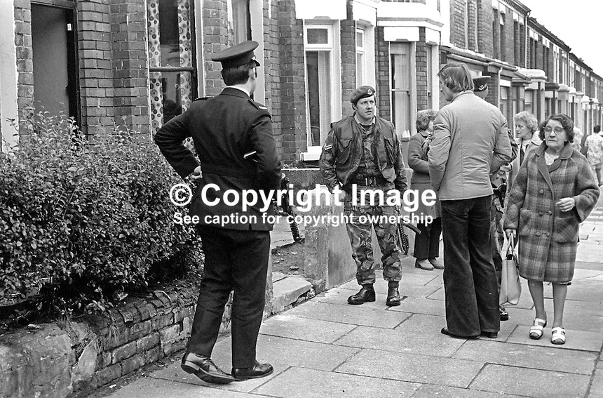 Police and army presence outside the house in My Lady's Road, Belfast, N Ireland, where 26 year old bar manager, Ronald Winters, from nearby Wilgar Street, was shot dead on 2nd October 1975. It is believed Mr Winters was killed by the UVF. Coincidentally the bar where he had been manager was frequented by UVF members. 197510020683<br />