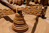 INDIA, Jharkhand, Sarwan, village Bhatkundi, potter makes one-way tea cups from clay, which are used for chai / INDIEN Jharkand , Sarwan, Dorf Bhatkundi, Toepfer stellt Einweg Teetassen aus Ton her