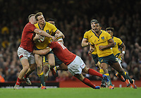 Australia's Dane Haylett-Petty is tackled by Wales' Hadleigh Parkes and  Ross Moriarty<br /> <br /> Photographer Ian Cook/CameraSport<br /> <br /> Under Armour Series Autumn Internationals - Wales v Australia - Saturday 10th November 2018 - Principality Stadium - Cardiff<br /> <br /> World Copyright © 2018 CameraSport. All rights reserved. 43 Linden Ave. Countesthorpe. Leicester. England. LE8 5PG - Tel: +44 (0) 116 277 4147 - admin@camerasport.com - www.camerasport.com