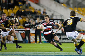 Kevin Farrell goes for the gap between Serge Lilo & Jimmy Gopperth. Air New Zealand Cup rugby game between Counties Manukau Steelers & Wellington played at Mt Smart Stadium on the 31st August 2007. The Score was 13 all at halftime, with Wellington going on to win 33 - 18.