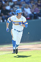 Brett Stephens (23) of the UCLA Bruins runs to first base during a game against the Oregon State Beavers at Jackie Robinson Stadium on April 4, 2015 in Los Angeles, California. UCLA defeated Oregon State, 10-5. (Larry Goren/Four Seam Images)