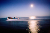 MEXICO, Baja, Magdalena Bay, Pacific Ocean, the boat heading out into the ocean at sunset