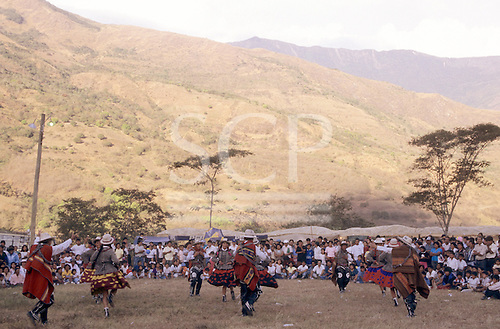 Quillabamba, Peru. Traditional dancers in traditional dress performing at a festival in the open air.