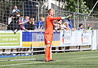 Robby McCrorie arranges the defensive wall for a free kick in the SPFL Betfred League Cup group match between Queen of the South and Motherwell at Palmerston Park, Dumfries on 13.7.19.