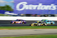 July 16, 2017 - Loudon, New Hampshire, U.S. - Denny Hamlin, Monster Energy NASCAR Cup Series driver of the FedEx Office Toyota (11), passes Martin Truex Jr, driver of the Wix Filters Toyota (78), runs in the NASCAR Monster Energy Overton's 301 race held at the New Hampshire Motor Speedway in Loudon, New Hampshire. Larson placed first in the qualifier. Eric Canha/CSM