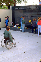 Leg less wheelchair vet age 52 viewing the Minnesota Vietnam Memorial.  St Paul Minnesota USA
