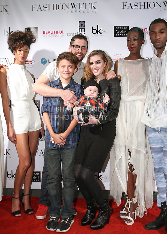 Fashion designer Bradley Jordan poses on red carpet with his family and models after his Bradley Douglas Jordan Spring Summer 2015 collection fashion show, during Fashion Week Brooklyn Spring Summer 2015.