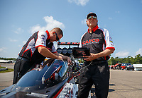Aug 19, 2017; Brainerd, MN, USA; Richard Hogan , crew chief for NHRA top fuel driver Steve Torrence during qualifying for the Lucas Oil Nationals at Brainerd International Raceway. Mandatory Credit: Mark J. Rebilas-USA TODAY Sports