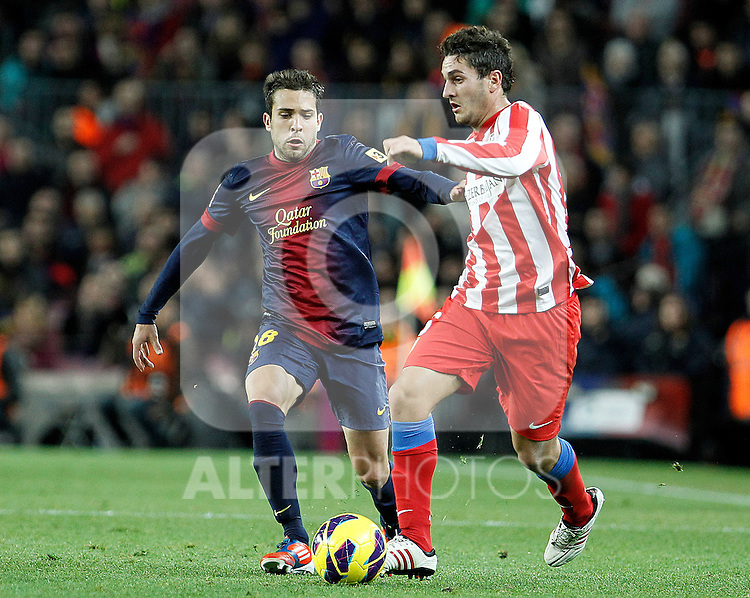 FC Barcelona's Jordi Alba (l) and Atletico de Madrid's Koke during La Liga match.December 16,2012. (ALTERPHOTOS/Acero)