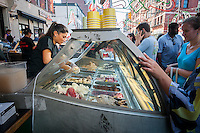 Visitors gorge on gelato from Ferrara Italian Pastries at the 89th annual Feast of San Gennaro in Little Italy in New York on Saturday, September 19, 2015.  (© Richard B. Levine)