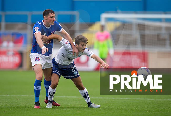 Scott Kashket of Wycombe Wanderers holds off Mike Jones of Carlisle United during the Sky Bet League 2 match between Carlisle United and Wycombe Wanderers at Brunton Park, Carlisle, England on 24 September 2016. Photo by Andy Rowland.