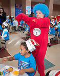 Students celebrate Dr. Seuss Day and National Reading Day at the Rice School with menbers of the Houston ISD Food Services Administration staff, March 3, 2014.