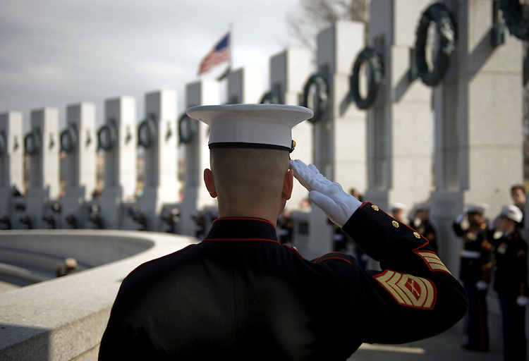 "A Marine salutes during the playing of ""Taps"" at the World War II Memorial during an event to honor WW II vets that served in the Pacific Theater, March 11, 2010.  The event coincided with the upcoming HBO miniseries entitled ""The Pacific."""