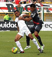 BOGOTA-COLOMBIA-03 -11-2013 : Wilson Morelo (Izq) de La Equidad Seguros disputa el balon con  Johny Vasquez ( Der)  delantero  del Atletico Junior durante partido por la fecha 17 de la Liga Postobon II-2013 ,jugado en el estadio Metroplitano de Techo de la ciudad de Bogota./ Wilson Morelo (L) of the Equidad Seguros disputes the ball with Johny Vasquez striker match Atletico Junior during the date 17 of the League Postobon II-2013, played at the Metropolitano  de Techo  Stadium  in Bogota city.Pohoito:VizzorImage / Felipe Caicedo / Staff