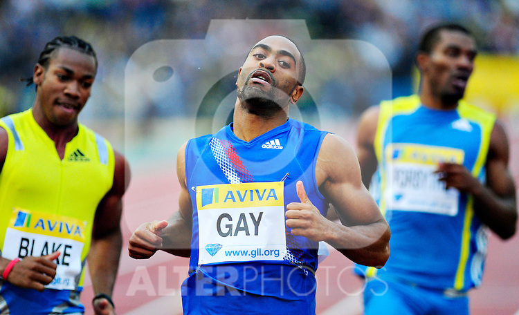 USA's Tyson Gay (R) finishes first during the Men's 100m heats during the Samsung Diamond League meeting at Crystal Palace in London August 13, 2010. Gay went on to win the final with a time of 9.78 seconds.