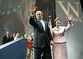 United States President George W. Bush and first lady Laura Bush wave as they depart a victory celebration at the Ronald Reagan Building, November 3, 2004 in Washington DC. After deciding not to contest the votes in the battleground state of Ohio, Democratic presidential candidate Sen. John Kerry (Democrat of Massachusetts) called President Bush to concede and congratulated him.   <br /> Credit: Mark Wilson / Pool via CNP