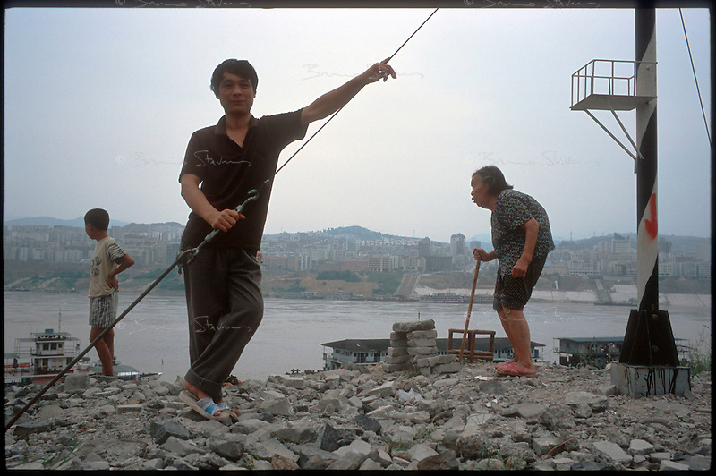 Fengdu, China, August 2003.Inhabitants contemplating the ruins in the old city of Fengdu, already half-destroyed to allow the Three Gorges Dam project to be completed.