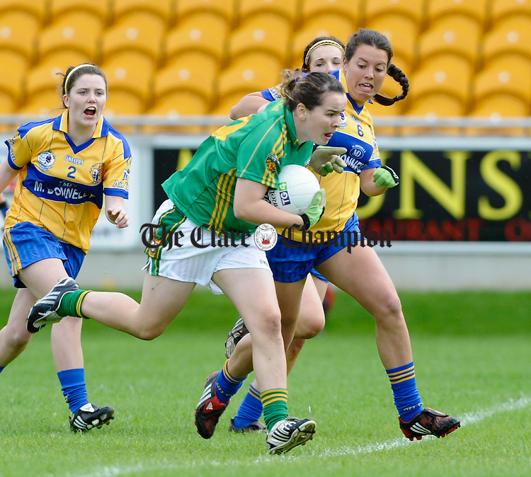 Donegal's Geraldine Mc Laughlin is tackled by Clare's Roisin Mc Mahon during their All-Ireland U-18A Minor championship final at Tullamore. Photograph by John Kelly.