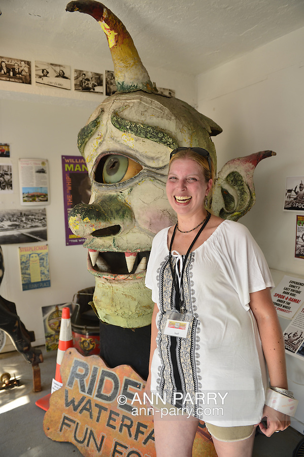 JENNIFER GARLAND, a volunteer historian at the Coney Island History Project, poses next to Spook-A-Rama Cyclops at The Fourth Annual History Day at Deno's Wonder Wheel Amusement Park.