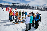 USA, Alaska, Juneau, the groups huddles together prior to going dog sledding, Helicopter Dogsled Tour flies you over the Taku Glacier to the HeliMush dog camp at Guardian Mountain above the Taku Glacier, Juneau Ice Field