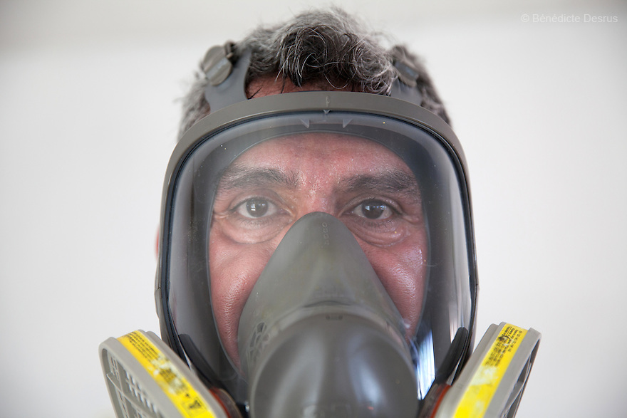 "Close-up of Donovan wearing his ventilator mask after the cleanup of an unsolved homicide in Cuernavaca, Morelos – one of Mexico's most dangerous cities on August 7, 2015. The 66-year-old victim was a retired economics lecturer from the local university, and was killed in January of this year. The cleanup took place eight months later. The victim's family has since moved away to avoid further trouble. They remarked that justice is slow in Mexico and expressed dissatisfaction with the police investigation, but appreciated Donovan's discretion and professionalism. Donovan Tavera, 43, is the director of ""Limpieza Forense México"", the country's first and so far the only government-accredited forensic cleaning company. Since 2000, Tavera, a self-taught forensic technician, and his family have offered services to clean up homicides, unattended death, suicides, the homes of compulsive hoarders and houses destroyed by fire or flooding. Despite rising violence that has left 70,000 people dead and 23,000 disappeared since 2006, Mexico has only one certified forensic cleaner. As a consequence, the biological hazards associated with crime scenes are going unchecked all around the country. Photo by Bénédicte Desrus"