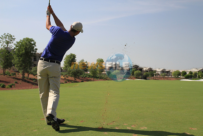 Martin Kaymer tees off on the par 3 4th hole during the opening round of Day 1 at the Dubai World Championship Golf in Jumeirah, Earth Course, Golf Estates, Dubai  UAE, 19th November 2009 (Photo by Eoin Clarke/GOLFFILE)