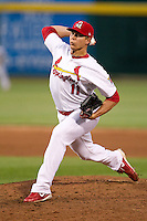Kevin Thomas (11) of the Springfield Cardinals delivers a pitch during a game against the Arkansas Travelers at Hammons Field on June 13, 2012 in Springfield, Missouri. (David Welker/Four Seam Images).