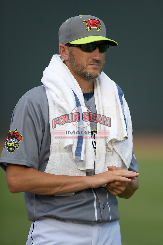 Pitching coach Josh Towers (19) of the Columbia Fireflies, playing as the Chicharrones de Columbia, before a game against the Charleston RiverDogs on Friday, July 12, 2019 at Segra Park in Columbia, South Carolina. The RiverDogs won, 4-3, in 10 innings. (Tom Priddy/Four Seam Images)