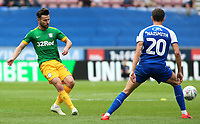 Preston North End's Joe Rafferty plays the ball past Wigan Athletic's Kal Naismith<br /> <br /> Photographer David Shipman/CameraSport<br /> <br /> The EFL Sky Bet Championship - Wigan Athletic v Preston North End - Monday 22nd April 2019 - DW Stadium - Wigan<br /> <br /> World Copyright © 2019 CameraSport. All rights reserved. 43 Linden Ave. Countesthorpe. Leicester. England. LE8 5PG - Tel: +44 (0) 116 277 4147 - admin@camerasport.com - www.camerasport.com
