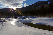 Franconia Notch State Park - Snow covered wetlands area along the Pemi Trail in the White Mountains, New Hampshire USA during the winter months.