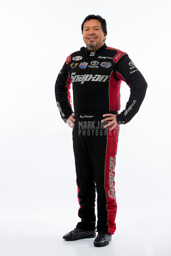 Jan 15, 2015; Jupiter, FL, USA; NHRA funny car driver Cruz Pedregon poses for a portrait during preseason testing at Palm Beach International Raceway. Mandatory Credit: Mark J. Rebilas-USA TODAY Sports