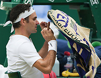 Roger Federer (SUI) throws a towel over his head between games in the Mens Final, Wimbledon Championships 2017, Day 13, Mens Final, All England Lawn Tennis & Croquet Club, Church Rd, London, United Kingdom - 16th July 2017