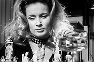 August 1970 --- French actress Genevieve Gilles playing chess in New York. Gilles starred in the 1970 film Hello-Goodbye and dated American producer Darryl Zanuck. --- Image by © JP Laffont