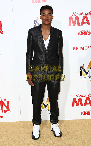 HOLLYWOOD, CA - JUNE 9: Trevor Jackson   attends the &quot;Think Like a Man Too&quot; Premiere at TCL Theatre in Hollywood, California on June 9, 2014.   <br /> CAP/MPI/mpi99<br /> &copy;mpi99/MediaPunch/Capital Pictures